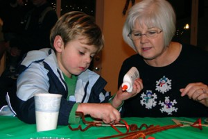 Liam Ward & Debbie Brown make reindeer ornaments.